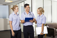 Young doctor with two nurses Royalty Free Stock Images
