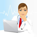 Young doctor using his laptop computer Royalty Free Stock Photo
