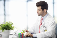 Young doctor using laptop Royalty Free Stock Photography