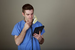 Young Doctor using a tablet Royalty Free Stock Photo
