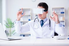 Young doctor with vr virtual reality headset working in the offi Stock Photography