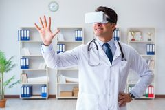 Young doctor with vr virtual reality headset working in the offi Stock Photo