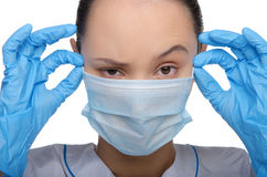 Young doctor wearing a mask and gloves stock images