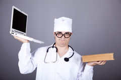 Young Doctor With Notebook And Book. Royalty Free Stock Image