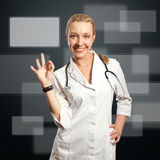 Young doctor woman shows ok Stock Photos