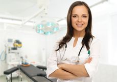 Young doctor woman in surgery room. Young positive brunette doctor woman in surgery room interior Royalty Free Stock Photos