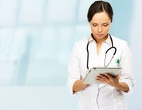 Young doctor woman taking notes Royalty Free Stock Photos