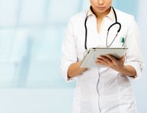 Young doctor woman taking notes Stock Photos