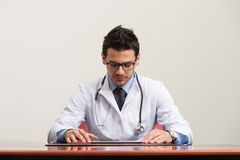 Young Doctor At Work Stock Image