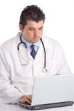 Young doctor working on a laptop stock photo