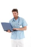 Young doctor working on laptop Royalty Free Stock Photos