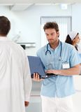 Young doctor working with laptop in hospital. Young doctor with laptop, people working in hospital Stock Photography