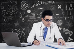 Young doctor working with notebook Royalty Free Stock Photo