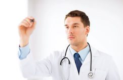 Young doctor working with something imaginary Stock Images