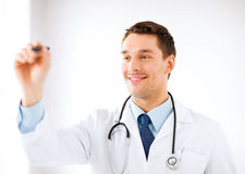 Young doctor working with something imaginary Stock Photos