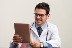 Young Doctor Working On Touchpad In Office Stock Images
