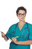 Young doctor writes a diagnosis. Studio Stock Photo