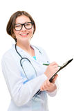 Young Doctor writes diagnosis to a folder Royalty Free Stock Photos
