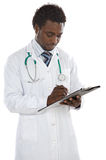 Young doctor writing. Attractive young doctor writing a over white background Royalty Free Stock Photos