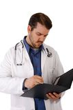Young Doctor Writing Notes Royalty Free Stock Image