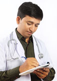 Young Doctor Writing Prescription. Indian Young Doctor Writing Prescription Royalty Free Stock Photos