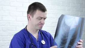 Young doctor with x-ray image. Healthcare, roentgen