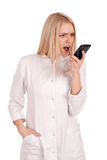 Young doctor yelling at someone on phone Royalty Free Stock Photo