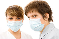 Young doctors. With protective mask, isolated in white Royalty Free Stock Photography