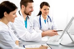 Young doctors. Group of young doctors discuss work Royalty Free Stock Image
