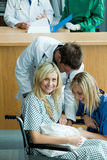 Young doctors attending a patient with a baby Stock Photos