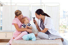 Young doctors attending to a baby Stock Images