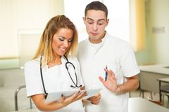 Young doctors looking at results in the office Royalty Free Stock Photo