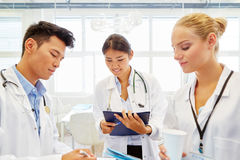 Young doctors making medical apprenticeship. In hospital royalty free stock photography