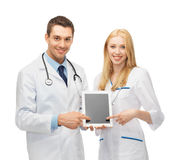 Young doctors pointing at tablet pc Stock Photo