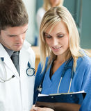 Young doctors reading a report Stock Photography