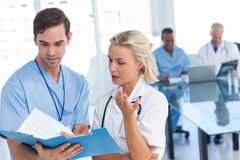 Young doctors talking about a blue file Stock Photo