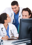 Young Doctors Team Discussing Stock Photos