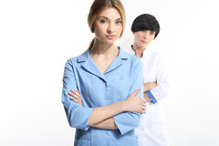Young doctors. Two young doctors on a white background Royalty Free Stock Images