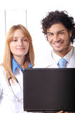 Young doctors use laptop Stock Image