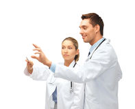 Young doctors working with something imaginary Royalty Free Stock Photo
