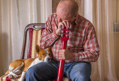 Young dog and mature musician having short rest. After performance Stock Images
