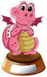 A young dragon above the trophy stand with an empty label Royalty Free Stock Photography