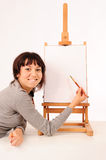 Young drawing girl Stock Photography