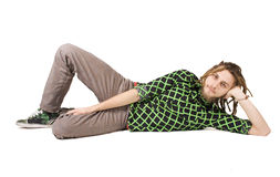 Young dreadlock man lies isolated Stock Image