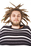Young dreadlock man lies isolated Royalty Free Stock Image