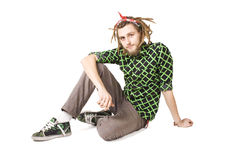 Young dreadlock man sits isolated Stock Photos