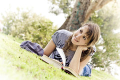Young dreamer. Young woman dreaming with stories and books royalty free stock images