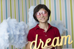 Young dreamer in pink glasses Royalty Free Stock Images