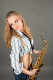 Young dreaming pretty blonde girl with sax Stock Photo