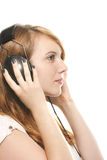 Young dreamy redhead woman listening to music with Stock Photo